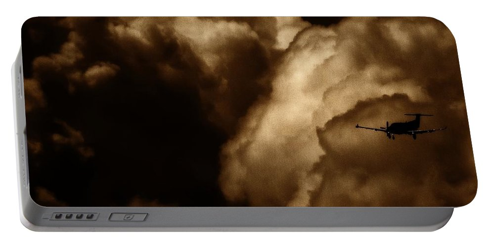 Pilatus Pc 12 Portable Battery Charger featuring the photograph Dark Clouds by Paul Job