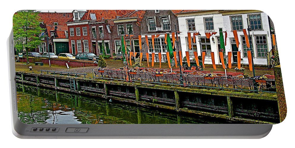 Decorations For Orange Day To Celebrate The Queen's Birthday In Enkhuizen Portable Battery Charger featuring the photograph Decorations For Orange Day To Celebrate The Queen's Birthday In Enkhuizen-netherlands by Ruth Hager