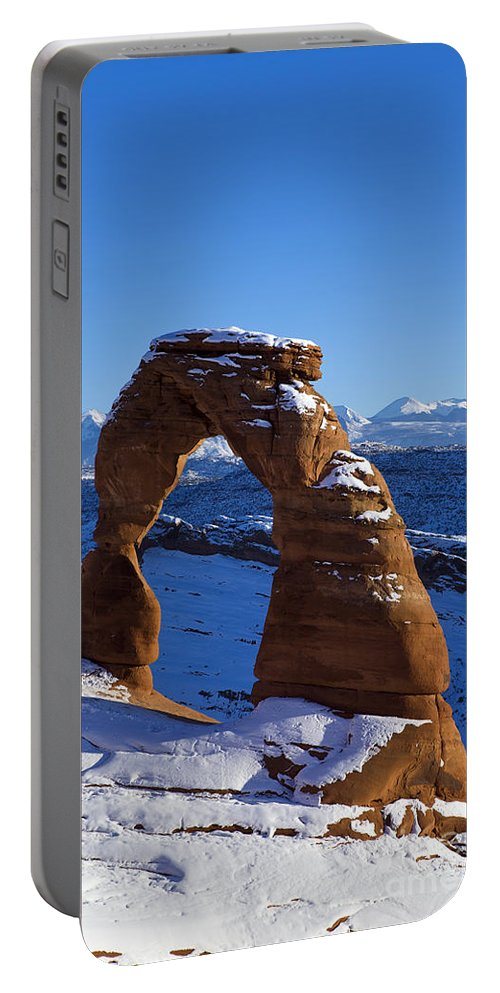 Arches Portable Battery Charger featuring the photograph Delicate Arch In Snow Arches National Park Utah by Jason O Watson