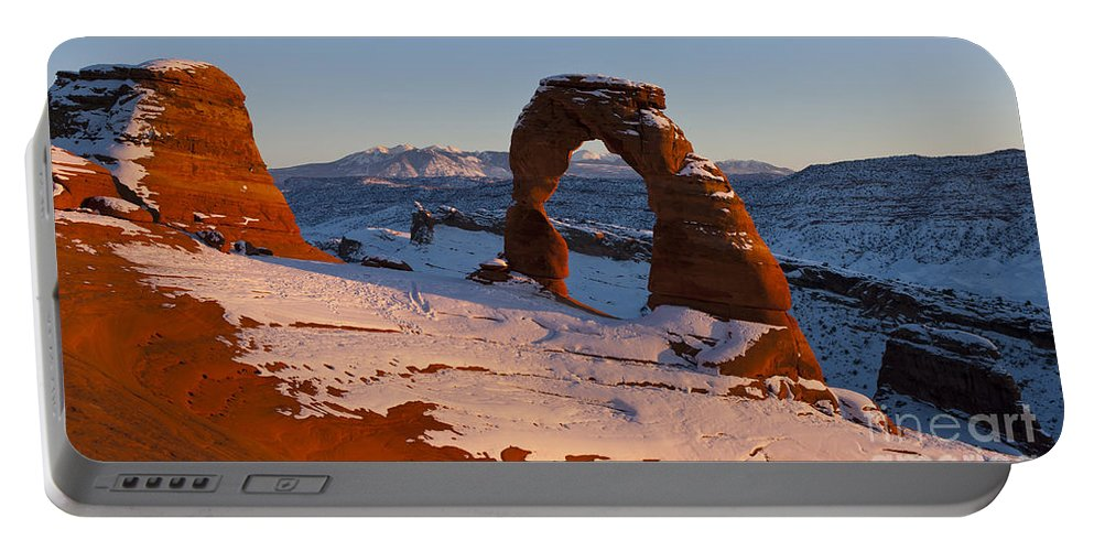 Arches Portable Battery Charger featuring the photograph Delicate Arch With Snow At Sunset Arches National Park Utah by Jason O Watson