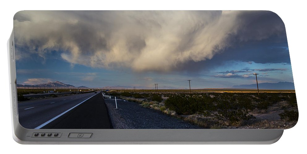 Nevada Portable Battery Charger featuring the photograph Desert Clouds by Angus Hooper Iii