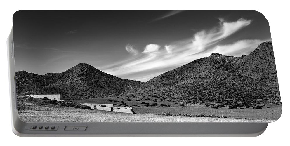Monocronme Portable Battery Charger featuring the photograph Desert Clouds by Guido Montanes Castillo