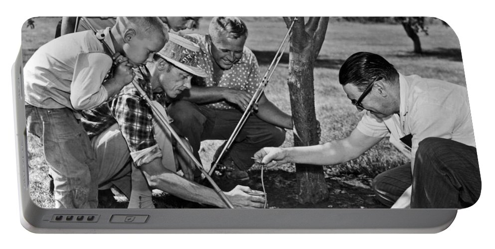 1954 Portable Battery Charger featuring the photograph Digging Worms For Fishing by Underwood Archives