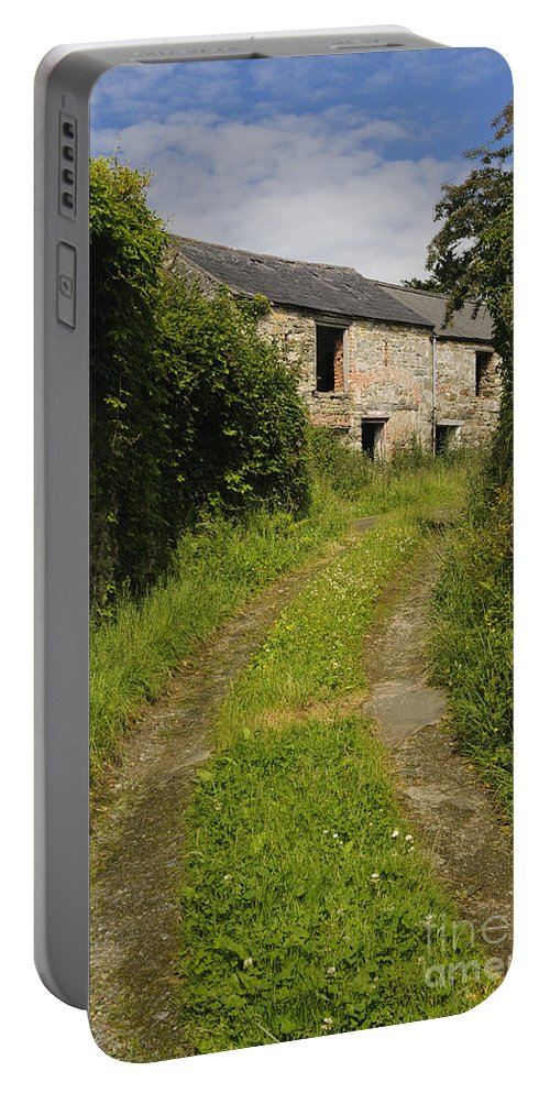 County Donegal Portable Battery Charger featuring the photograph Dirt Path To Stone Building by John Shaw