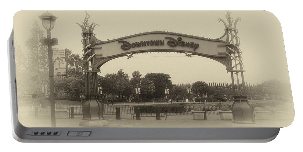 Disney Portable Battery Charger featuring the photograph Disneyland Downtown Disney Signage 02 Heirloom by Thomas Woolworth