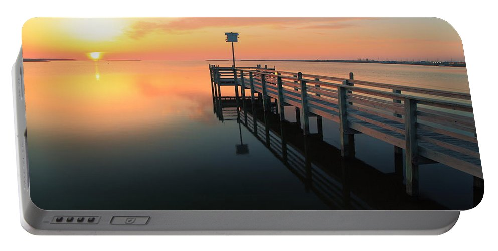 Dock Portable Battery Charger featuring the photograph Dock On The Sunset Sound by Roupen Baker
