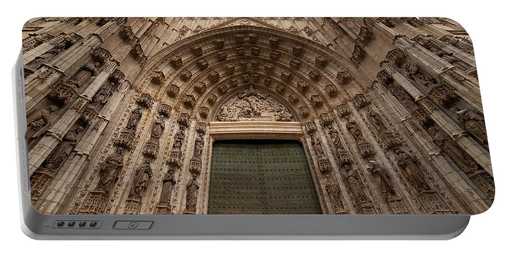 Seville Portable Battery Charger featuring the photograph Door Of Assumption Of The Seville Cathedral by Artur Bogacki