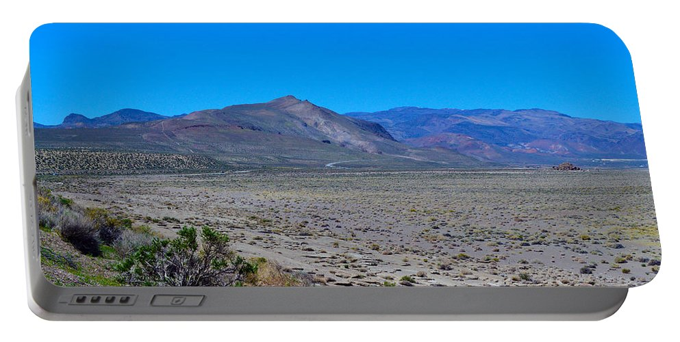 Rock Portable Battery Charger featuring the photograph Dried Lake Beach by Brent Dolliver