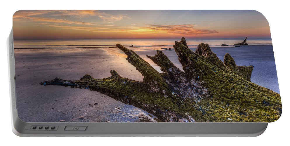 Clouds Portable Battery Charger featuring the photograph Driftwood On The Beach by Debra and Dave Vanderlaan