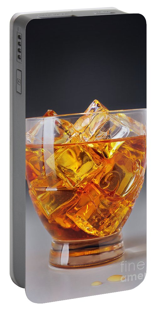 Alcohol Portable Battery Charger featuring the photograph Drink On Ice by Carlos Caetano