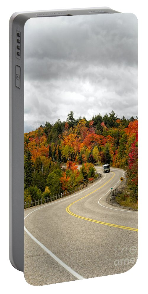 Algonquin Portable Battery Charger featuring the photograph Driving Through Algonquin Park In Fall by Les Palenik