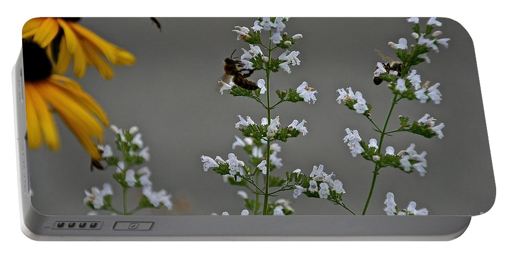 Flower Portable Battery Charger featuring the photograph Drones by Susan Herber