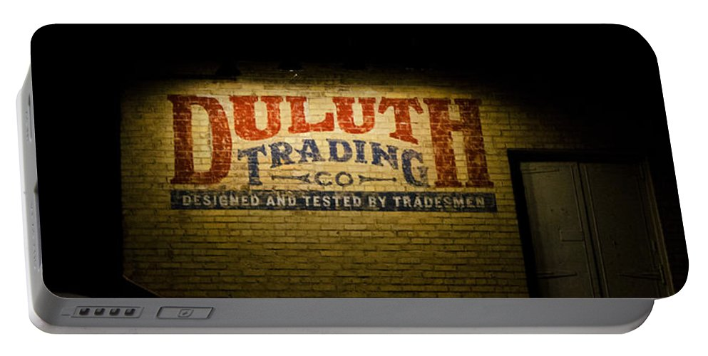 Sign Portable Battery Charger featuring the photograph Duluth Trading Company by Susan McMenamin