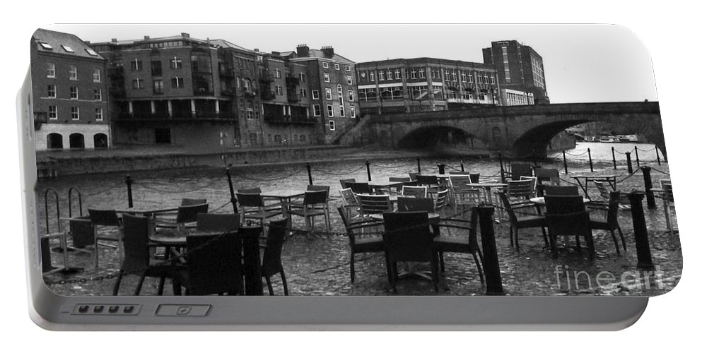The River Ouse Portable Battery Charger featuring the photograph Empty Tables by Joan-Violet Stretch