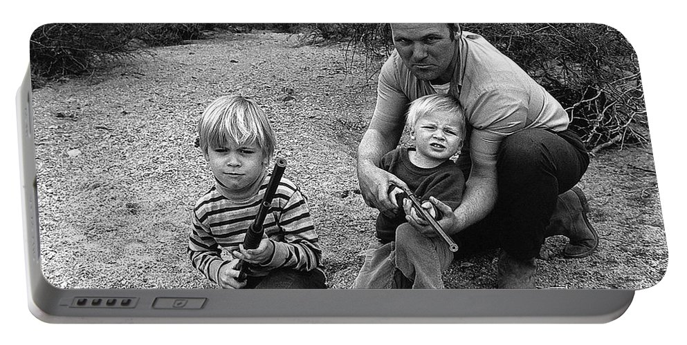 Ex Green Beret Barry Sadler In Target Practice With Son's Thor And Baron Tucson Arizona 1971 Portable Battery Charger featuring the photograph Ex Green Beret Barry Sadler In Target Practice With Son's Thor And Baron Tucson Arizona 1971 by David Lee Guss