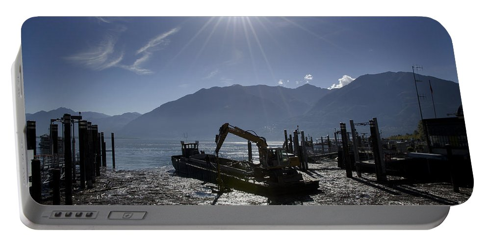 Excavator Portable Battery Charger featuring the photograph Excavator Clean A Harbor by Mats Silvan