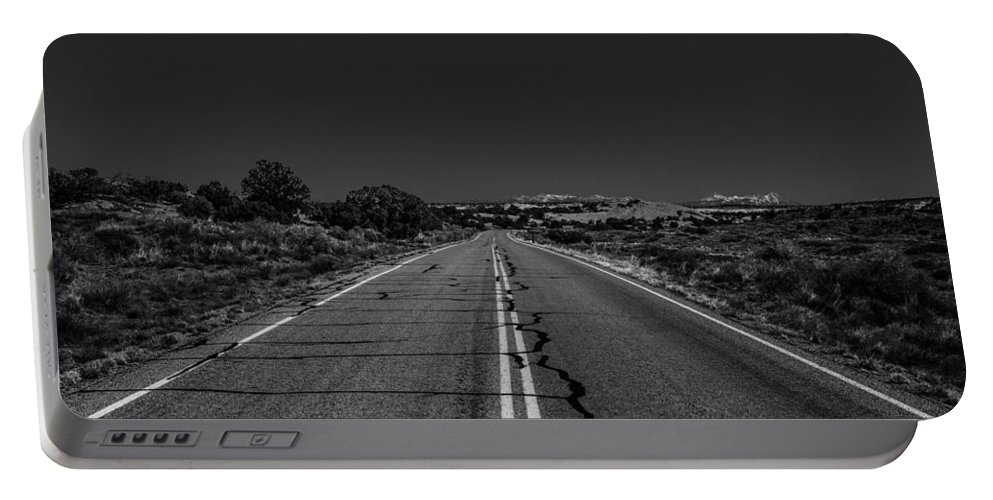 Moab Portable Battery Charger featuring the photograph Exodus by Angus Hooper Iii