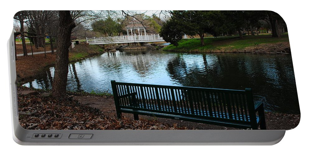 Duck Pond Portable Battery Charger featuring the photograph Fall Leaves Carpet And Metal Sofa by Pamela Smale Williams