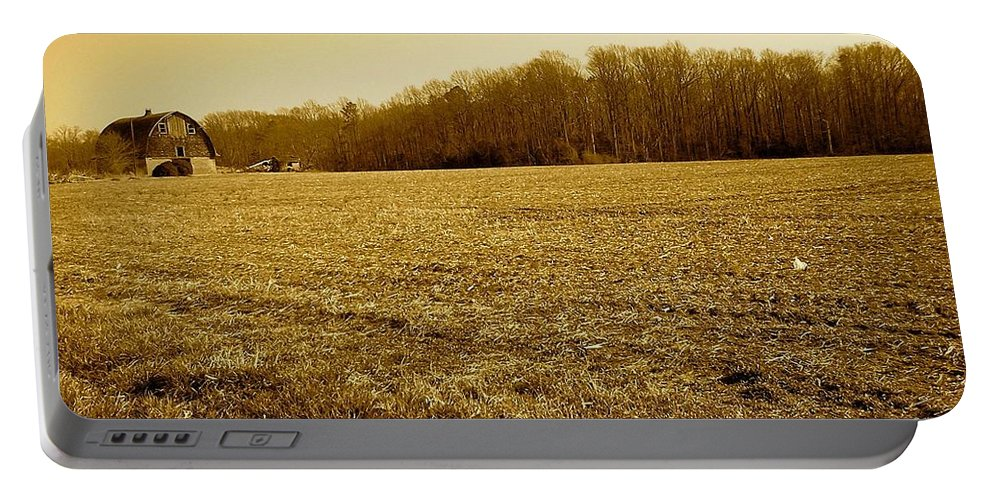 Farm Portable Battery Charger featuring the photograph Farm Field With Old Barn In Sepia by Chris W Photography AKA Christian Wilson