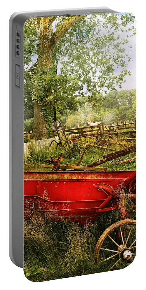Savad Portable Battery Charger featuring the photograph Farm - Tool - A Rusty Old Wagon by Mike Savad