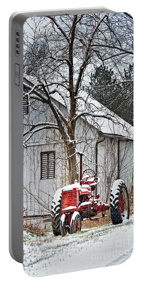 Farmall Tractor Portable Battery Charger featuring the photograph Farmall Tractor In Winter by Timothy Flanigan