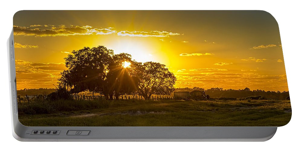 Farmland Portable Battery Charger featuring the photograph Farmland Sunset by Marvin Spates