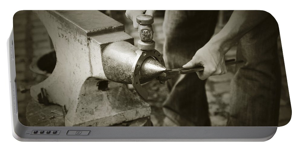 Farrier Portable Battery Charger featuring the photograph Farrier Making Horseshoe by Liz Leyden