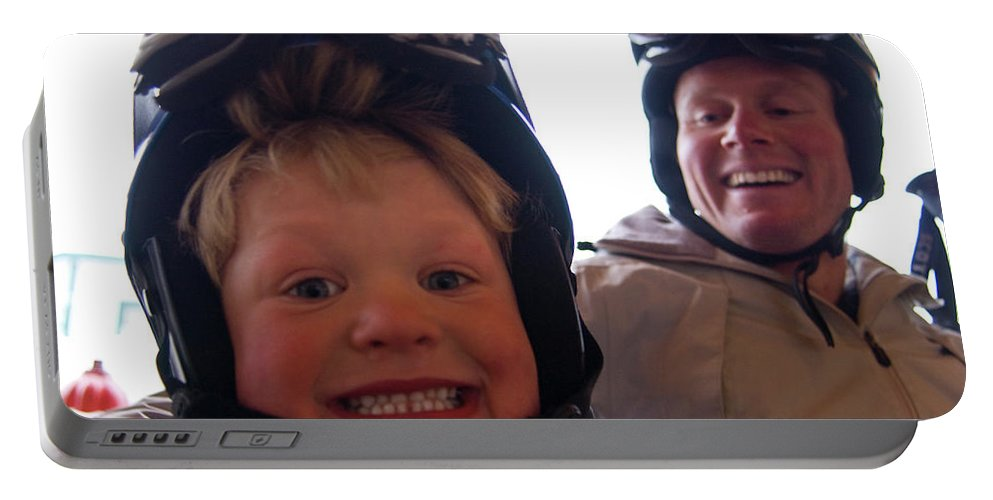 Big Mountain Portable Battery Charger featuring the photograph Father And Son At Big Mountain by Heath Korvola