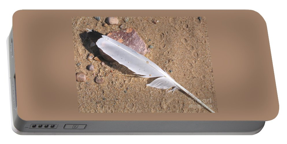 Beach Portable Battery Charger featuring the photograph Feather On Damp Sand by Ann Horn