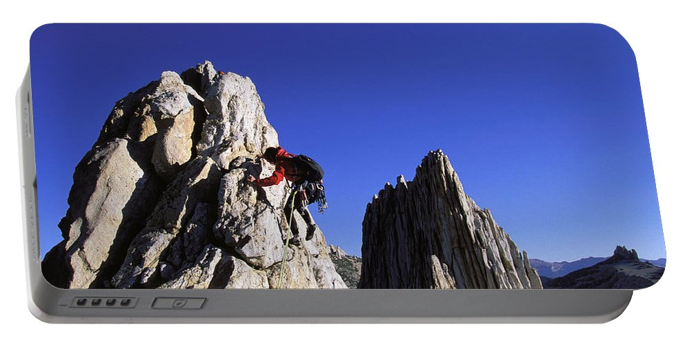 Accomplishment Portable Battery Charger featuring the photograph Female Climber Reaching The Top by Corey Rich