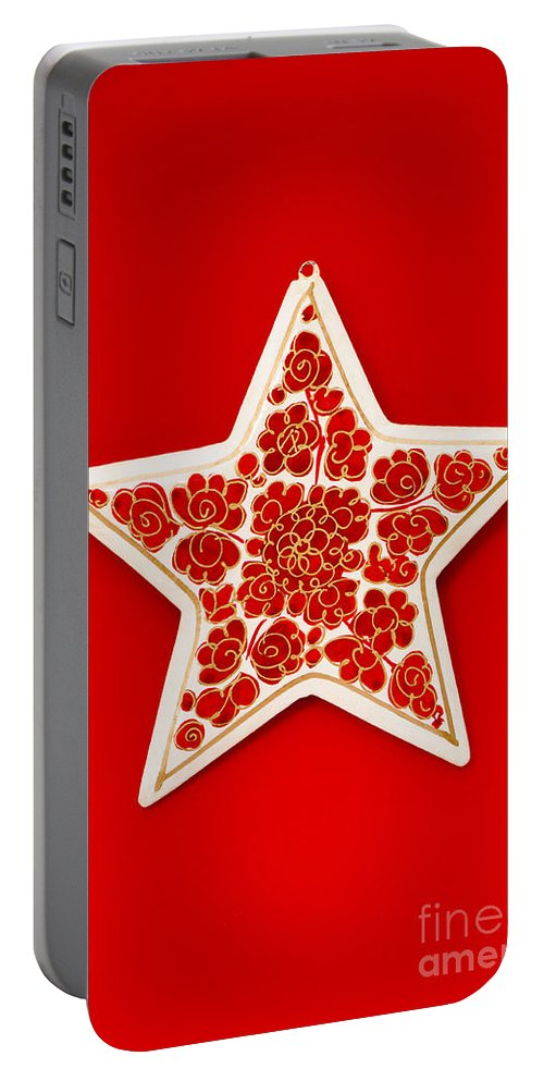Background Portable Battery Charger featuring the photograph Festive Star by Anne Gilbert