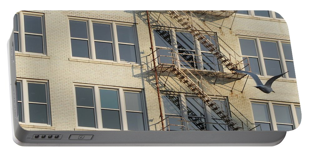 Fire Escape Portable Battery Charger featuring the photograph Fire Escape And Bird by Anita Burgermeister