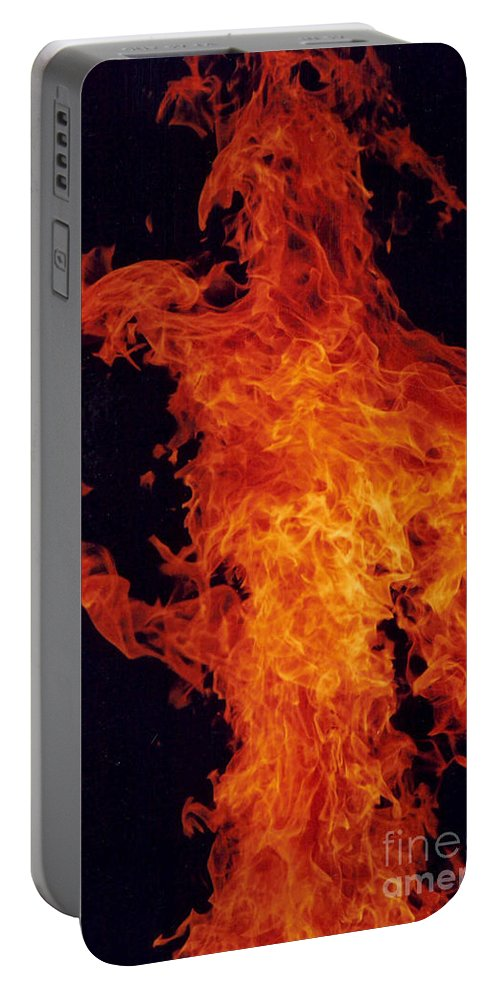 Flames Of A Large Camp Fire Portable Battery Charger featuring the photograph Fire Man by Jeffery L Bowers