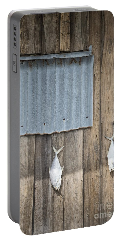 Abstract Portable Battery Charger featuring the photograph Fish Drying Outside Fisherman House by Jacek Malipan