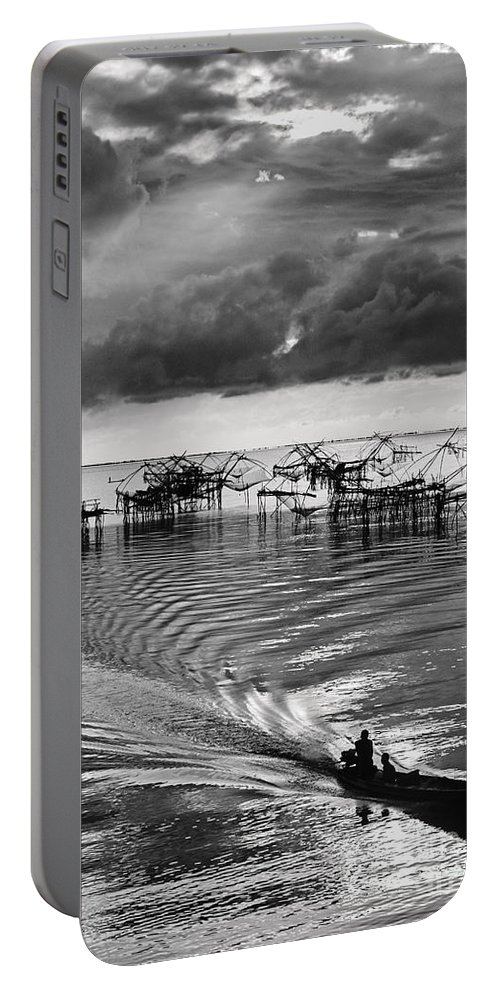 Fishing Portable Battery Charger featuring the photograph Fisherman Returns Home by Kim Pin Tan