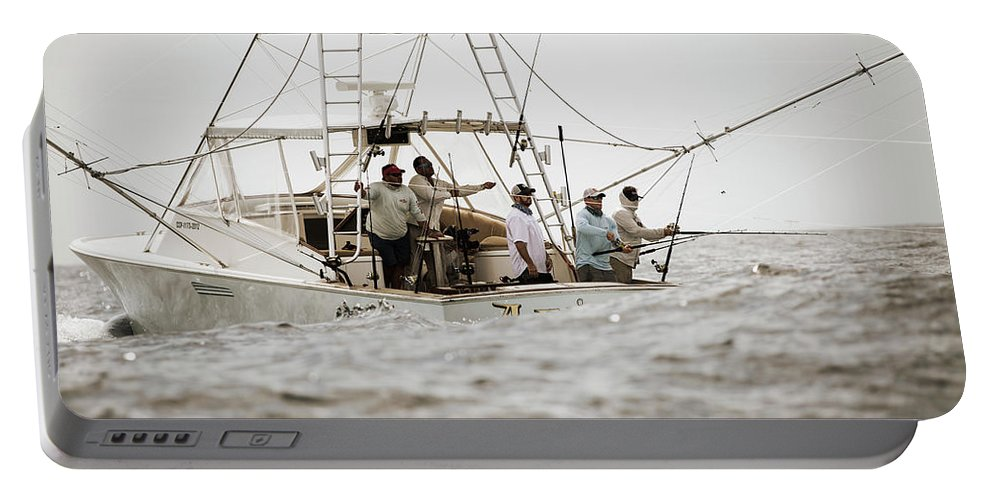 Fishing Reel Portable Battery Charger featuring the photograph Fishermen Reel In Line From The Back by Chris Ross