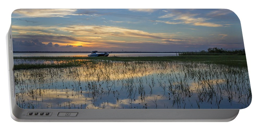 Boats Portable Battery Charger featuring the photograph Fishing Boat At The Lake by Debra and Dave Vanderlaan