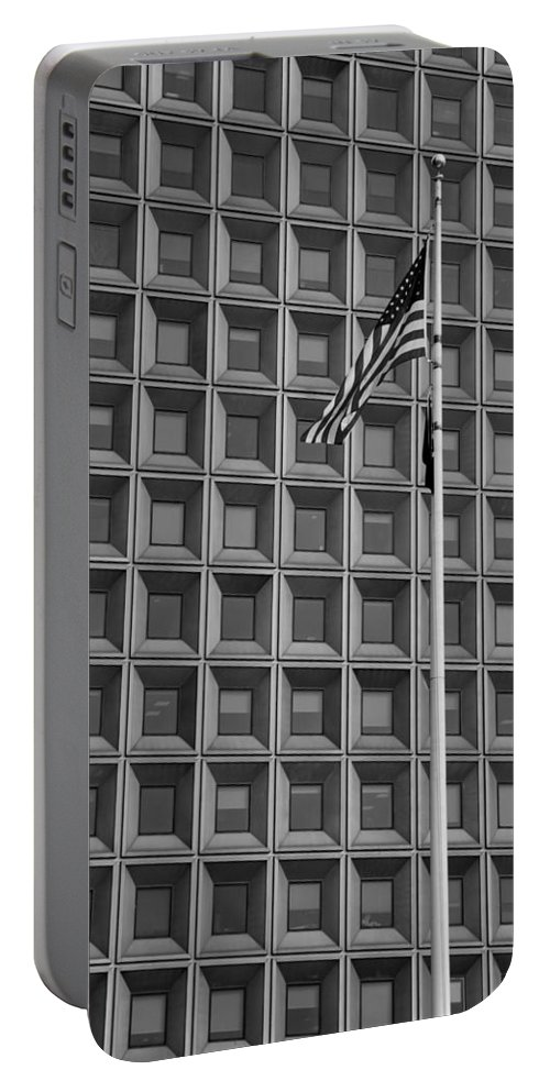 Abstract Portable Battery Charger featuring the photograph Flag And Windows In Black And White by Rob Hans