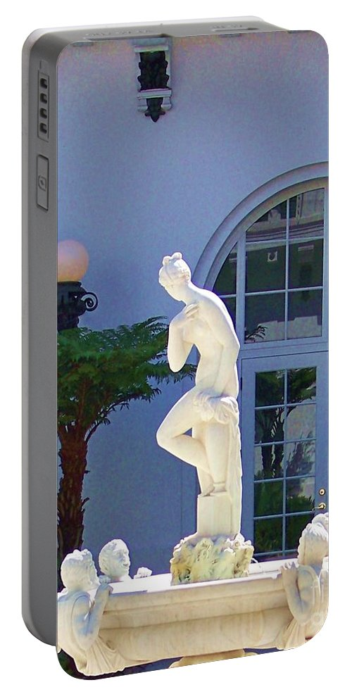 Flagler Portable Battery Charger featuring the photograph Reflection Of A Courtyard by Chuck Hicks
