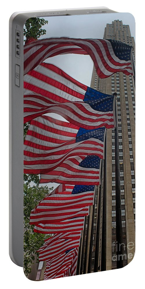 Flag Portable Battery Charger featuring the digital art Flags At Rokefeller Plaza by Carol Ailles