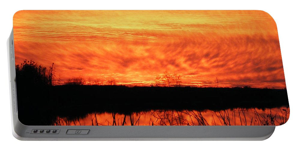 Sunset Portable Battery Charger featuring the photograph Flamed Sunset by Lizi Beard-Ward