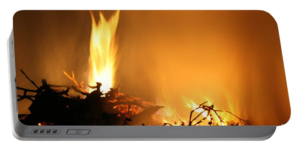 Fire Portable Battery Charger featuring the photograph Flames by Lali Kacharava