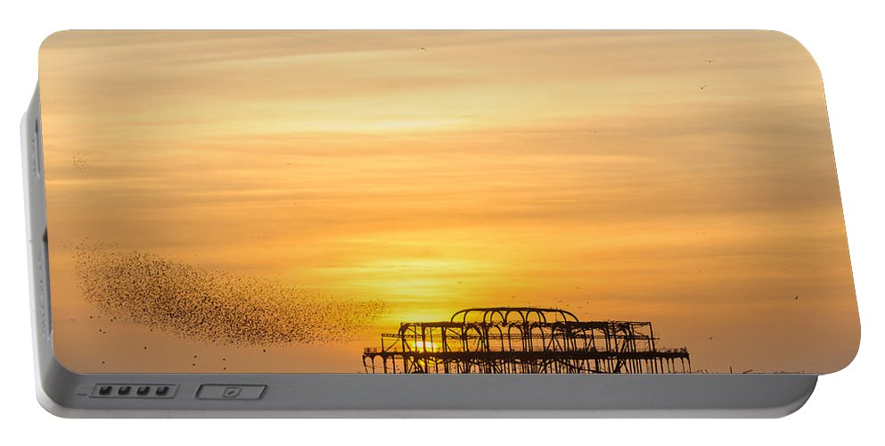 Brighton Portable Battery Charger featuring the photograph Flock Of Starlings Over The West Pier In Brighton by Dutourdumonde Photography