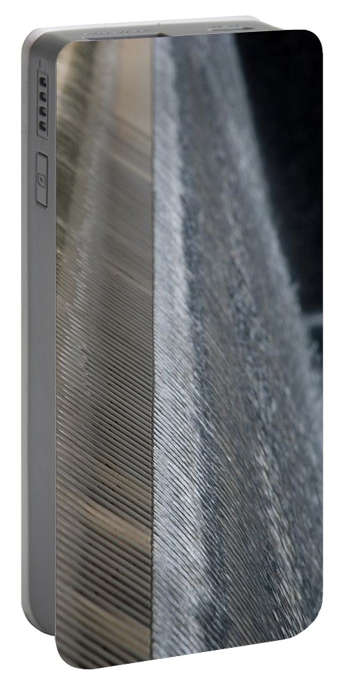 Wtc Portable Battery Charger featuring the photograph Fluted Water by Rob Hans