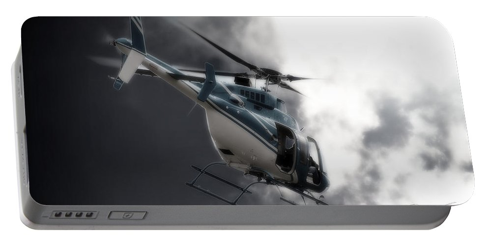 Bell 407 Portable Battery Charger featuring the photograph Flying Into The Light by Paul Job