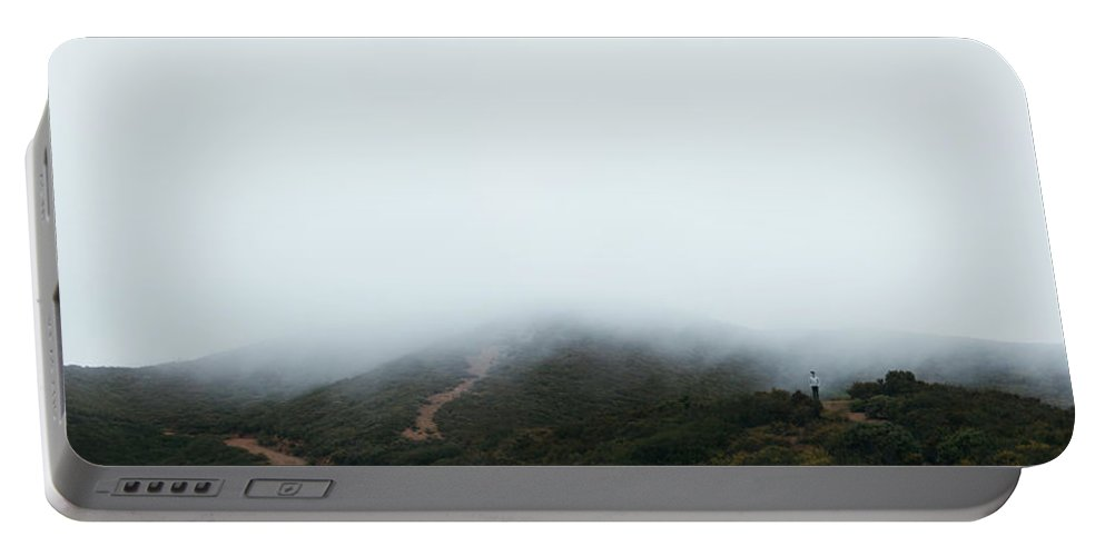 Growth Portable Battery Charger featuring the photograph Foggy Hills by Amelia Fletcher