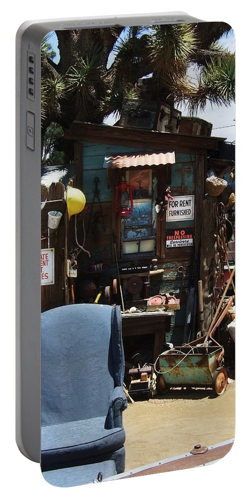 Clutter Portable Battery Charger featuring the photograph For Rent by Steve Ondrus