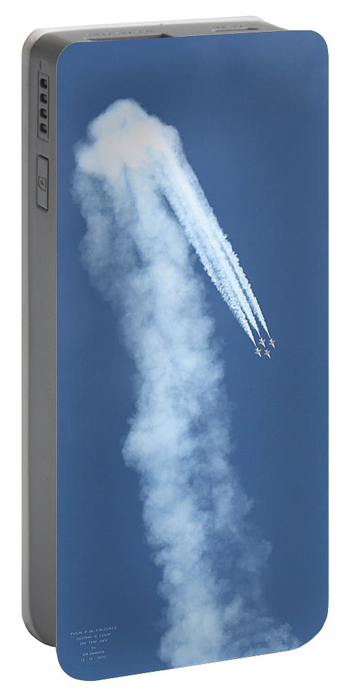 F16s Portable Battery Charger featuring the photograph Four F-16 Falcons Doing A Loop In The Sky by Carl Deaville