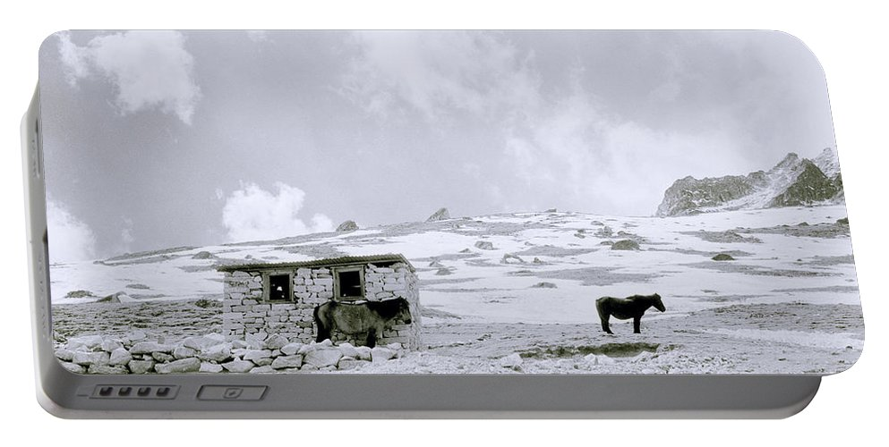 Himalaya Portable Battery Charger featuring the photograph Freeze by Shaun Higson