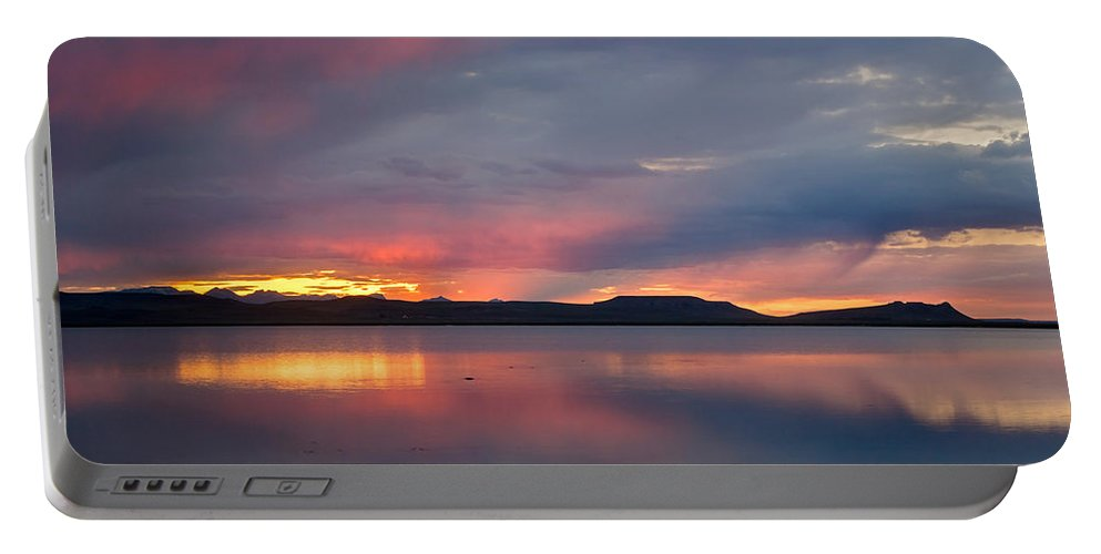 Sunset Portable Battery Charger featuring the photograph Freezeout Lake Sunset by Jack Bell